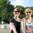 Two  beautiful woman with sunglasses on park - ストック写真