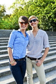 Two beautiful woman with sunglasses on the stairs — Stock Photo