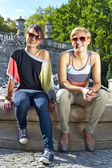 Two beautiful woman with sunglasses on park — Stock Photo