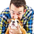 Man with his dog on white background - Foto Stock