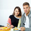 Couple on date in restaurant eating a cake — Stock Photo #16345131
