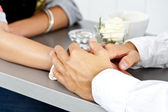 Hands on the table together in love in restaurant — Stock Photo