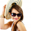 Woman on white background with sunglasses and hat - Stok fotoğraf