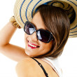 Woman on white background with sunglasses and hat - Стоковая фотография