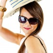 Woman on white background with sunglasses adn hat - Stok fotoğraf