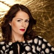Glamour woman on gold background — Stockfoto