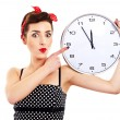 Pin-up girl on white background holding clock — Stock Photo