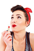 Pin-up woman with lipstick on white background look up — Stock Photo