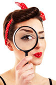 Woman with magnifier on white background — Stock Photo