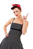 Frau Pin-up-Stil auf weißem Hintergrund mit finger — Stockfoto