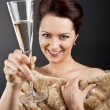Woman with champagne flute — Stock Photo