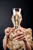 Glass of champanage holding by woman — Stock Photo