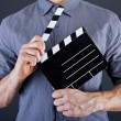 Stock Photo: Mwith movie clap over dark background