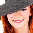 Portrait of beautiful young woman wearing black hat — Stock Photo