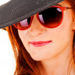 Young woman in black hat and sunglasses — Foto Stock