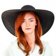 Portrait of attractive elegant woman in black hat — Stock Photo #26844585