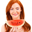 Cheerful red hair young womholding watermelon — Stock Photo #26844603