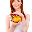 Red hair woman with fruits in her hands — Stock Photo