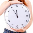 Stock Photo: Young beautiful woman with the clock isolated in white