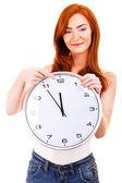 молодая красивая женщина с часами, изолированных в белых указывая — Стоковое фото