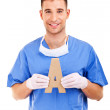 Stock Photo: Young doctor holding letter a