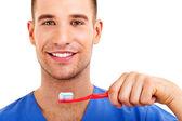 En ung man borsta hans tänder isolerad på vit bakgrund — Stockfoto
