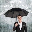 Businessman holding an umbrella protect from problems — Stock Photo