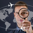 Man with magnifier and world map on dark background  — Stock Photo