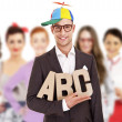 Group of business people with businessman leader in funny hat on — Stock Photo #29796959