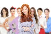 Businesswoman leading a business team and smiling — Stock Photo