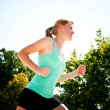 Young lady running — Stock Photo