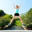 Stock Photo: Athlete jumping shot from low angle with sky background