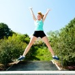 Athlete jumping shot from low angle with sky background — Stock Photo #30582869