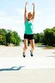 Athlete jumping shot from low angle with sky background — Foto de Stock