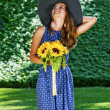 Carefree girl is happy in field with flowers — Foto de Stock