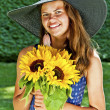 Carefree girl is happy in field with flowers — Stock Photo
