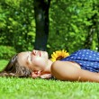 Young girl lying on green grass — Stock Photo #33884003