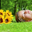 Young girl lying on green grass — Stock Photo