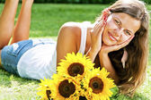 Beautiful woman enjoying daisy field, nice female lying down in — Foto de Stock