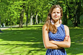 Beautiful young brunette woman outdoor on the meadow on a summer — Stock Photo