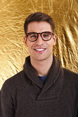 Young handsome man with great smile wearing fashion eyeglasses a — Stok fotoğraf