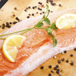 Stock Photo: Salmon fillet with rosemary and lemon