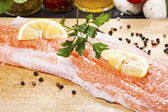 Salmon fillet with rosemary and lemon — Stock Photo