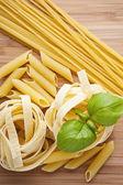 Different kinds of pasta (spaghetti, fusilli, penne, linguine) — Stock Photo