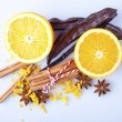 Sliced orange with cinnamon sticks and anise — Stock Photo #40296705