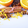 Sliced orange with cinnamon sticks and anise — Stock Photo