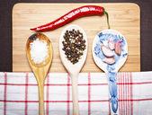Chili garlic pepper and salt on wood background — Stock Photo