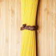 Bunch of spaghetti on wooden background — Stock Photo #40655481