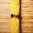Bunch of spaghetti on wooden background — Stock Photo #40655483