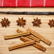 Cinnamon sticks, brown sugar, anise stars and vanilla beans — Stock Photo
